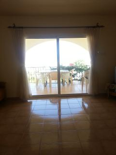 Living area and patio entrance to front balcony