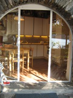 Kitchen on ground floor with access to garden and spectacular view. Equipped with all the mod-cons.