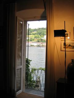 View of the garden and lake from the lounge. Exit to the balcony which runs the length of the facade
