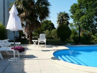 Heaed salt water pool with loungers