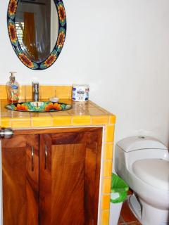 Bright cheery bathroom with an ocean breeze.