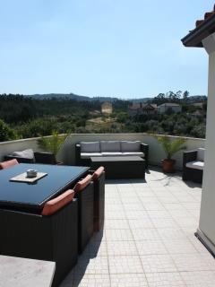 Looking out from the patio doors, onto our spacious, well furnished sun terrace!