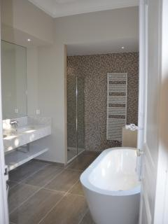 Master bedroom new large en-suite with  free standing bath,large shower, double basin