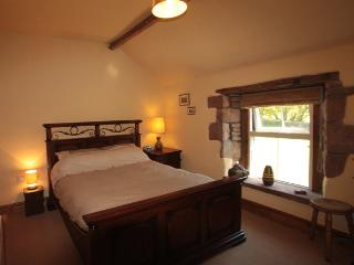 Master bedroom with king size bed, tv/dvd