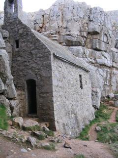 St Govan's chapel built into nearby cliffs.