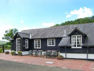 THE STABLINGS COTTAGE next to golf course, canal and woodlands in Newtown Ref