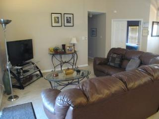 Family Room with TV/DVD, double bed settee. Ceiling fan