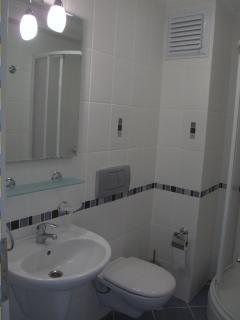 Three modern well presented bathrooms