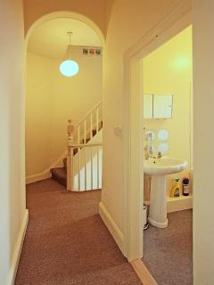 Bright and light landing with stairs up to loft room and down to lower mezzanine room