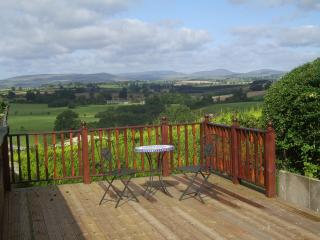 the Coach House is surrounded by decking on 3 sides with great views