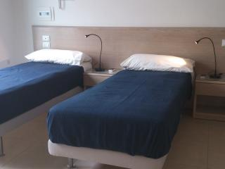 The first bedroom Castore in the version with two single beds.