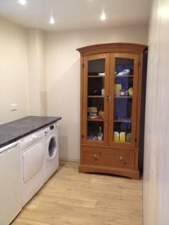 Laundry room, with extra fridge, freezer and storage