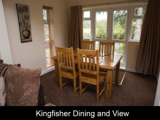 Kingfisher Cottage Dining area with view out towards the river