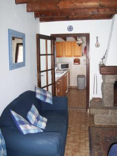 The view of the well-equipped kitchen from the living room