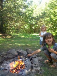 Toast marshmallows around the fire
