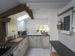 The kitchen has oven, fridge freezer, dishwasher and coffee machine