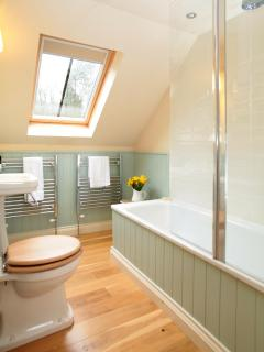 The bathroom with overhead shower