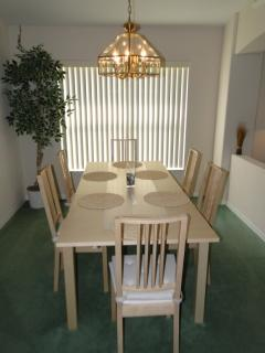 Main dining area with extendable table to comfortably seat 8