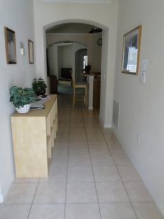 Entrance with lounge ahead, dining area  left, breakfast bar, kitchen small dining table to  right