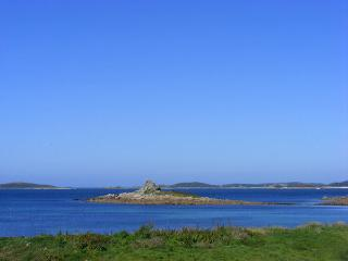 The stunning sea view from Golden Eagle's sitting room across the sea to Samson, Tresco and Bry