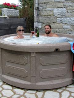 Enjoy a relaxing soak in our year round outdoor hot tub overlooking the river and waterfalls