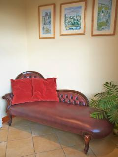 Chaise longue in dinning room.