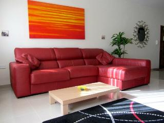 Living Area with large leather sofa