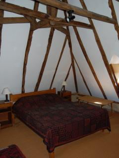 The master bedroom under the oak beams