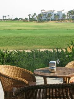Enjoy a drink at the resort clubhouse while watching the golf!