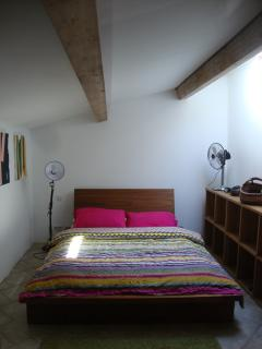 Bedroom with double bed and beamed ceiling