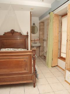 Ensuite bedroom with antique french bed