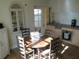 Sunny kitchen leads straight onto the rear patio area for additional dining