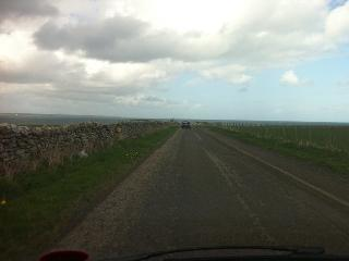 Only two miles out of Wick and Tesco and it looks like we're driving straight into the sea.