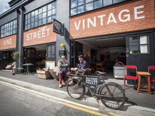 The property is above a vintage market and coffee shop
