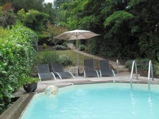 Beautiful private pool area with sun loungers, separate decking area with more