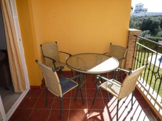 Terrace complete with table and 4 chairs overlooking the pool and gardens