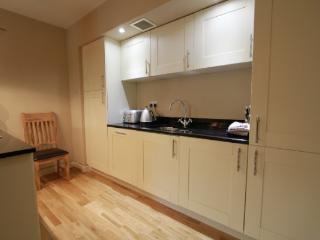 Fully equipped kitchen of the Abbey Garden apartment