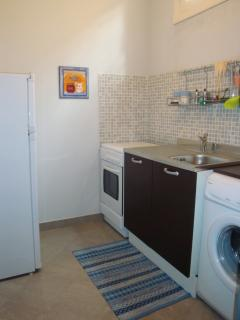 The second small kitchen with everything you need and washing machine