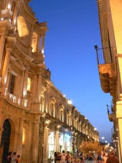 Glimpse of main street of Noto by night within walking distance