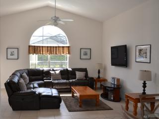 Main lounge- new recliner sofa, flat screen tv (full cable service), stereo and DVD player