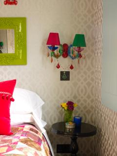 Lavish wall sconces and beautiful butterfly wallpaper