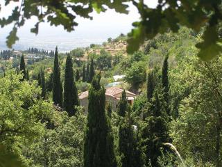Tuscan homeestled into the hillside with expansive views over the Cortona valley to Lake Trasimeno.