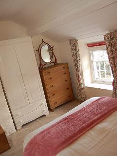 The main bedroom with a view over the stream