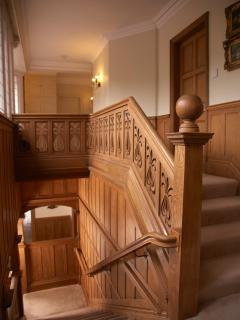 Light wood panelled staircase with a wealth of original features