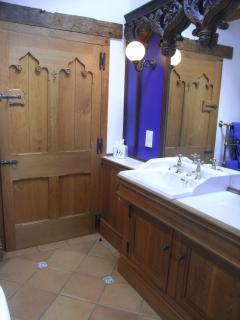 Unique bathroom fittings and door hand made by the owner, with reclaimed gothic church carvings.