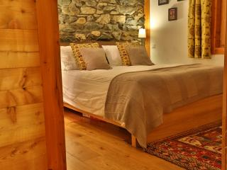 Master bedroom with original stone wall