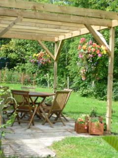 Private garden areas with outdoor seating and views into the surrounding woodland.