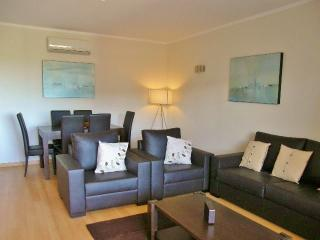 light and spacious living room leading onto private balcony with great views of ria formosa