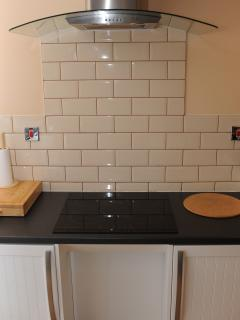 Cooker hob and extractor