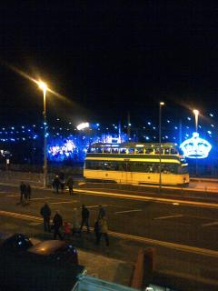 View of vintage tram and illuminations outside apartments. Also Promenade bus stop right outside.